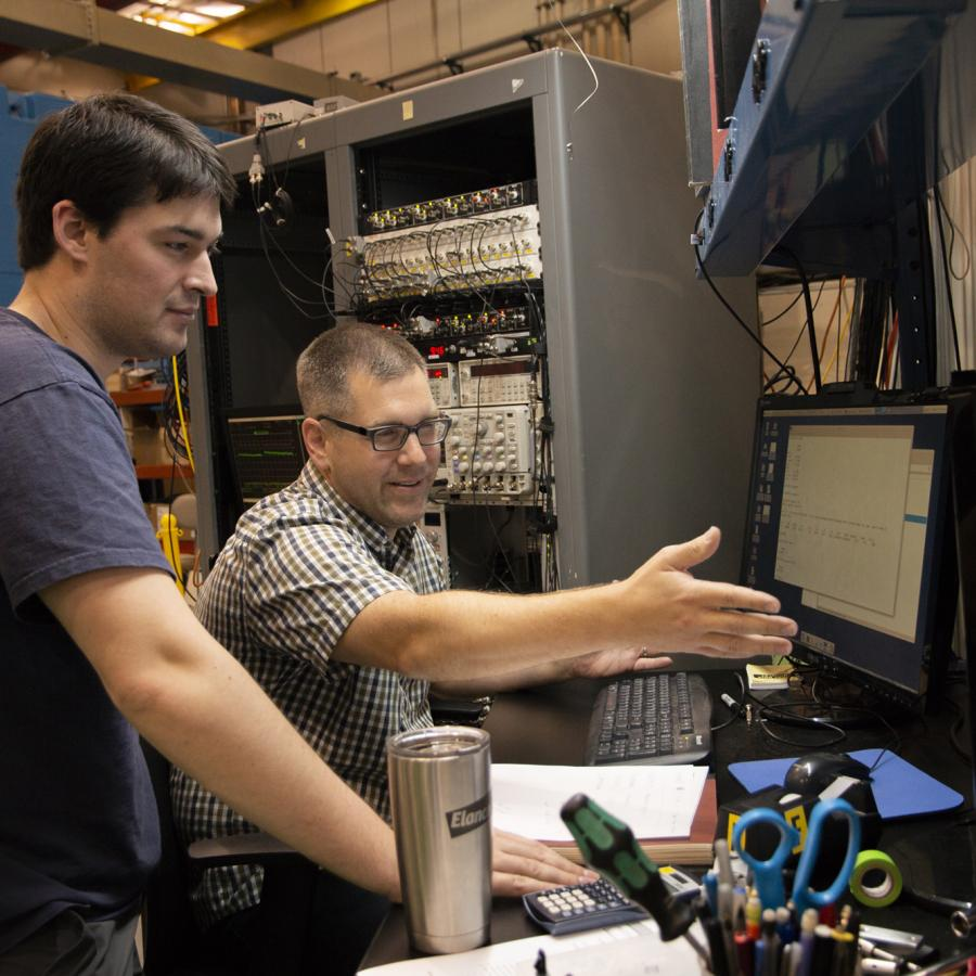 Justin Mach, right, from Caterpillar works with CHESS Graduate Student Chris Budrow during Justin's latest beam time.