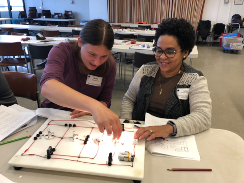 Cornell graduate student Robin Bjorkquist works with Lymari Fuentes-Claudio  on the Foutan Boards electric circuit investigation during the October 13 workshop.